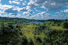 The lake in the forest. Near Moscow suburbs,Clouds, field and lake Stock Image