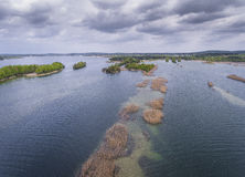 Lake and forest during spring time. View from above. Pogoria IV Stock Photos