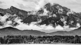 Lake forggen and alps. Black & white landscape from lake forggen over allgäu woods to some alp mountains Stock Photos