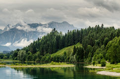 Lake forggen and alps. Landscape from lake forggen over allgäu meaddows and woods to some alp mountains Royalty Free Stock Image
