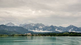 Lake forggen, fuessen and alps. Landscape from lake forggen over fuessen and woods to some alp mountains royalty free stock photography