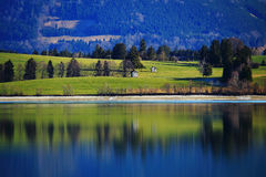 Landscape idyll deep colors at fall. Idyll at a lake by deep rich colors of the landscape in the Bavarian Alps in Germany at late fall Stock Photo