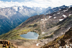 Lake in form of a heart. Alps Royalty Free Stock Images