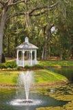 Lake Fountain with Woodland Gazebo Stock Image