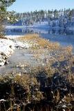 Lake freezing over Stock Image