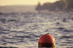 LAKE FRONT BUOY Stock Photography