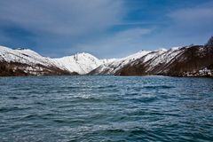 Lake in front of a snowy mountain Royalty Free Stock Image