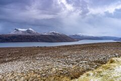 Lake in front of the snowy mountains