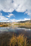 The lake in front of Songzanlin Monastery background at Shangri- Royalty Free Stock Photography