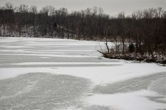Lake frozen and still. Stark black and white photograph royalty free stock image