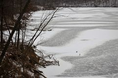Lake frozen and still. Stark black and white photograph stock photo