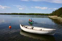 Lake fun. A lake in denmark with boat -and canot royalty free stock photography