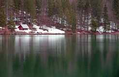 Lake of Fusine with the hut on the shore Royalty Free Stock Photos