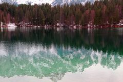 Lake of Fusine with the snowy Alps Royalty Free Stock Image