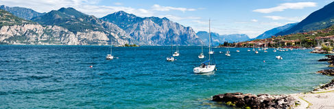 Lake Garda. Panoramic view of boats on Lake Garda with Alpine mountains in background, Italy royalty free stock image