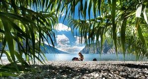 Lake Garda. Girl on the beach - Lake Garda - italy stock photos