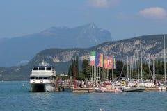 Lake Garda boat at pier in Bardolino Italy Stock Images