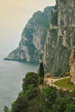 Lake Garda costal cliffs, Italy. Cliffs overhanging the Northern Italian lake Garda coat royalty free stock photos