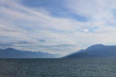 Lake Garda in the cold morning haze royalty free stock photography