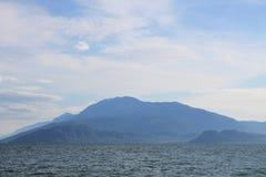 Lake Garda in the cold morning haze royalty free stock image