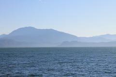 Lake Garda in the cold morning haze stock photo