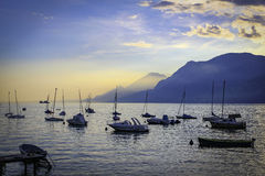 Lake Garda Harbour at sunset with boats stock images