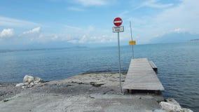 Forbidden pass. Lake garda Italy beach Stock Photography