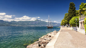 Lake Garda, Italy. High mountains and sailing boat on the Lake Garda stock image