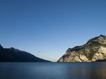Lake Garda Italy (Lago di Garda). Tranquil morning at Lake Garda in northern Italy, big sky, mountains and calm water Royalty Free Stock Photos