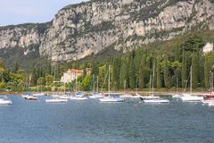 Lake Garda, the largest lake in Italy, situated on the edge of tthe Dolomites, Italy. GARDA, ITALY - SEPTEMBER 30, 2018: Lake Garda, the largest lake in Italy stock photography