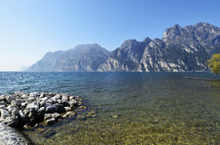 Lake Garda and the mountains seen from Torbole beach Royalty Free Stock Photos