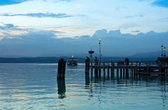 Lake Garda Pier and the Last Ferry for the day Stock Photos