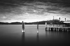 Lake Gardasee in Northern Italy. Jetty at lake Gardasee in Northern Italy, Europe, long time exposure shot in black and white Royalty Free Stock Image
