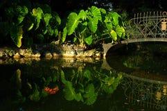 Lake GARDEN. Italian garden with lake and bridge, Como, Italy Royalty Free Stock Images