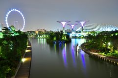 A lake at Garden by the Bay by night Stock Images