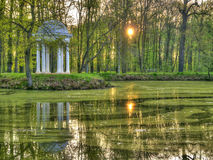Lake and gazebo. A lake and a gazebo with the sun shining through the trees Royalty Free Stock Images