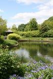 Lake with gazebo and gardens Royalty Free Stock Image