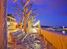 Lake Geneva Frozen Waterfront. Frozen waterfront at Versoix's Lake Geneva, at dawn during February 2012 in one of the coldest winter experienced in Europe Royalty Free Stock Photography