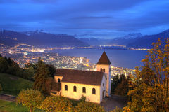 Lake Geneva from Mont Pelerin, Switzerland. Nightscape of the church of Mont Pelerin, a small village above the so-called swiss riviera region of Lake Geneva ( Stock Photos