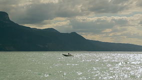 Lake Geneva, a picturesque pond between high mountains, floating boat stock video footage