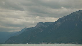 Lake Geneva, a picturesque pond between high mountains stock footage