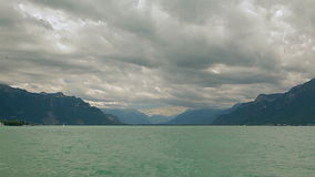 Lake Geneva, a picturesque pond between high mountains. Lake Geneva on the north side of the Alps, shared between Switzerland and France. It is one of the stock video footage