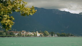 Lake Geneva, a picturesque pond between high mountains. Lake Geneva on the north side of the Alps, shared between Switzerland and France. It is one of the stock video