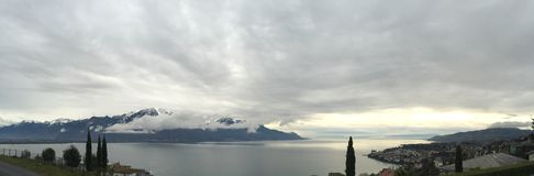 Lake of Geneva Suisse. Montreux Zwitserland mountain clouds stock image