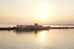 Lake Geneva at Sunset; Lausanne. Boat on Lake Geneva at Sunset; Lausanne; Switzerland Stock Photography