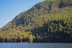 Lake George fall color sailboat and power boat Stock Images