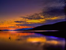 Lake George at sunrise with Loon and clouds stock photos