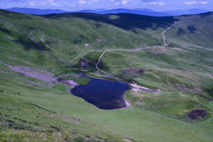 Lake Gerashaska. NnGerashasko Lake Photo (Ukraine), with a bird's-eye view, surrounded by green grassy slopes of the massif Svydovets Royalty Free Stock Photography