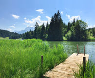 Lake Geroldsee with wooden boardwalk Royalty Free Stock Photo