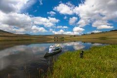 Lake Girl Dog Canoe Mirror Stock Photo